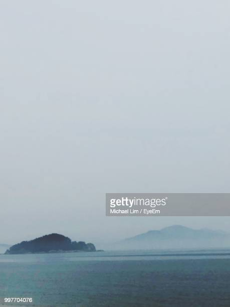 scenic view of sea against sky - incheon stock pictures, royalty-free photos & images