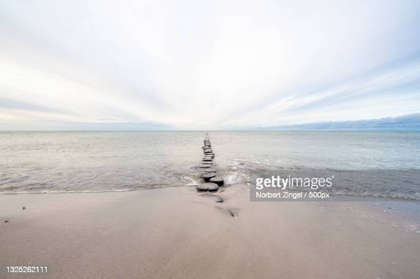 scenic view of sea against sky,hiddensee,germany - norbert zingel stock-fotos und bilder