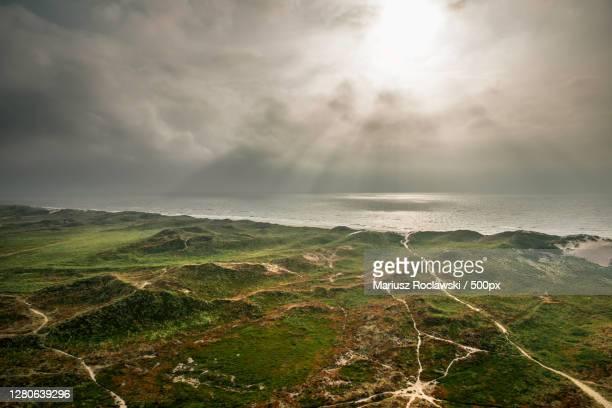 scenic view of sea against sky,hvide sande,denmark - mariusz roclawski stock-fotos und bilder
