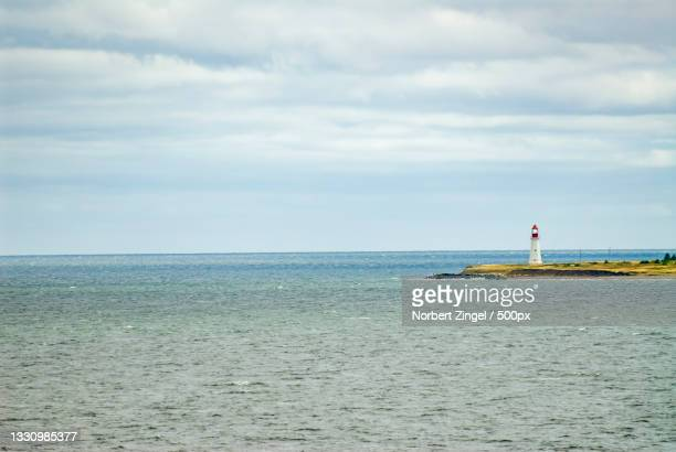scenic view of sea against sky,newfoundland and labrador,canada - norbert zingel stock-fotos und bilder