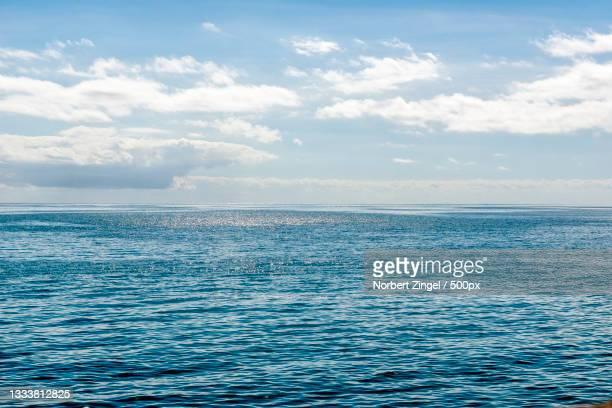 scenic view of sea against sky,st aubin,jersey - norbert zingel stock-fotos und bilder
