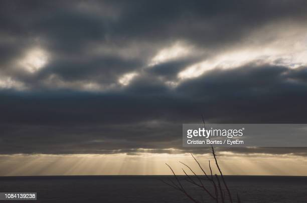 scenic view of sea against storm clouds - bortes stock pictures, royalty-free photos & images