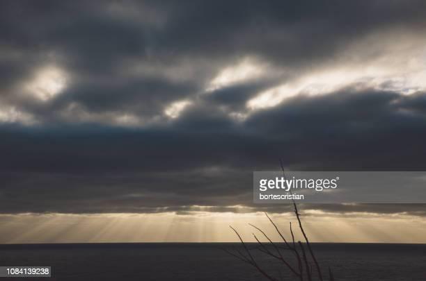 scenic view of sea against storm clouds - bortes foto e immagini stock