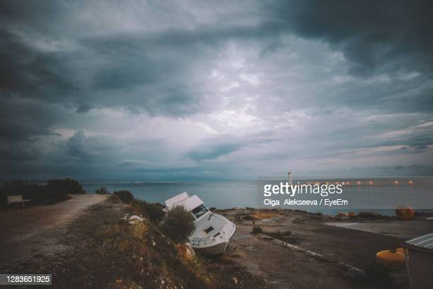 scenic view of sea against storm clouds - アルプマリティーム ストックフォトと画像