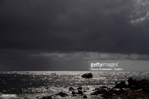 scenic view of sea against storm clouds - stutterheim stock photos and pictures