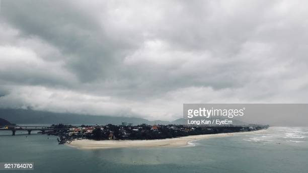 Scenic View Of Sea Against Storm Clouds