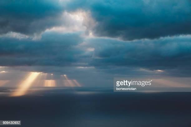 scenic view of sea against storm clouds - bortes photos et images de collection