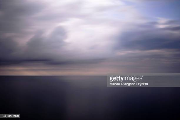 scenic view of sea against storm clouds - lake ontario stock pictures, royalty-free photos & images