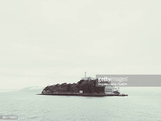 Scenic View Of Sea And Alcatraz Island Against Clear Sky