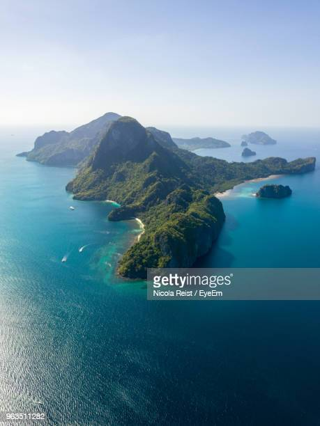 scenic view of sea and bay against sky - el nido stock pictures, royalty-free photos & images