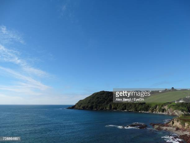 Scenic View Of Sea And Blue Sky