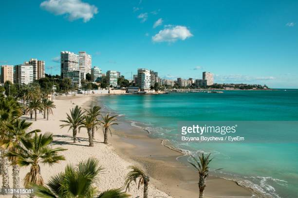scenic view of sea and buildings against blue sky - valencia spain stock pictures, royalty-free photos & images