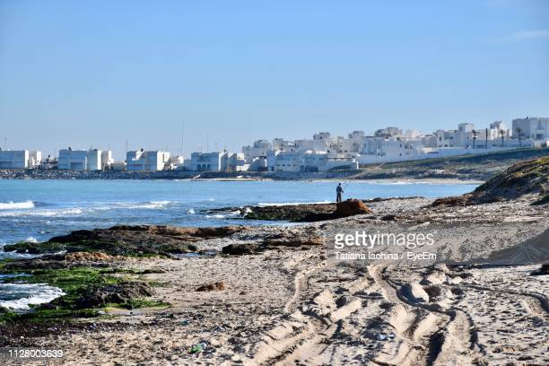 scenic view of sea and buildings against clear sky - tunisia stock pictures, royalty-free photos & images