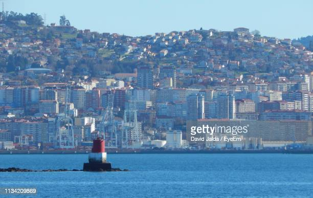 scenic view of sea and buildings against clear sky - vigo stock pictures, royalty-free photos & images