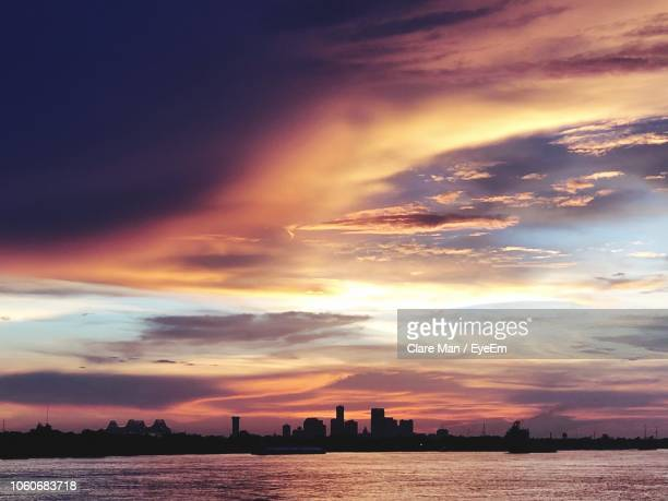 scenic view of sea and buildings against sky during sunset - la waterfront stock pictures, royalty-free photos & images