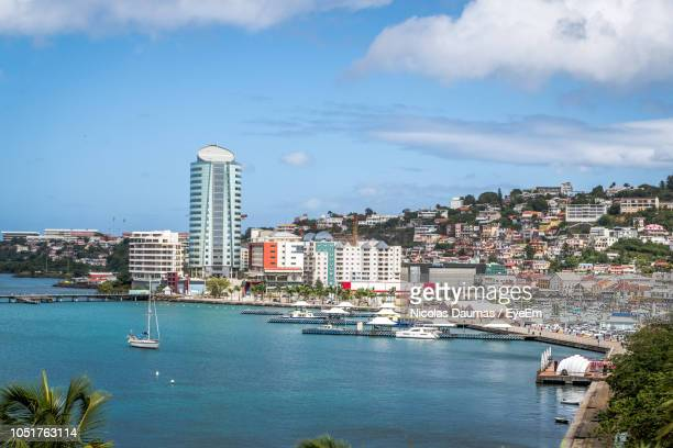 scenic view of sea and buildings against sky - french overseas territory stock pictures, royalty-free photos & images