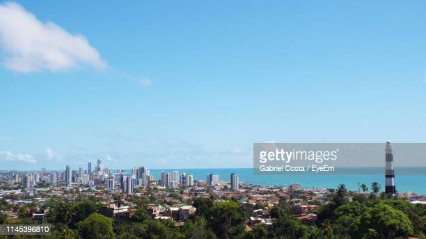 scenic view of sea and buildings against sky - recife stock pictures, royalty-free photos & images