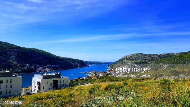 scenic view of sea and buildings against sky - ljubomir belic stock pictures, royalty-free photos & images