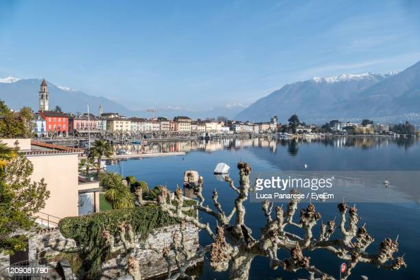 scenic view of sea and buildings against sky - ascona stock pictures, royalty-free photos & images