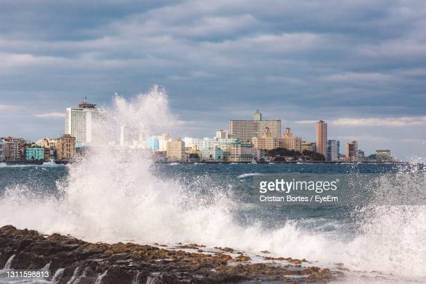 scenic view of sea and buildings against sky - bortes stock pictures, royalty-free photos & images