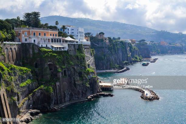 scenic view of sea and buildings against sky - sorrento stock pictures, royalty-free photos & images