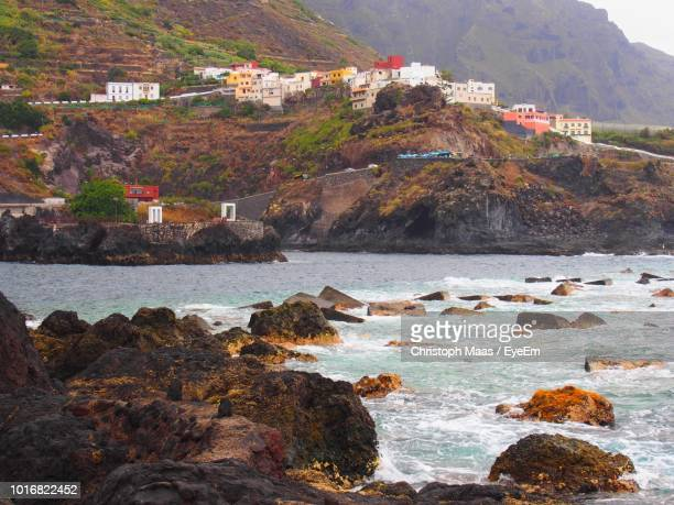 scenic view of sea and buildings - atlantic islands stock pictures, royalty-free photos & images