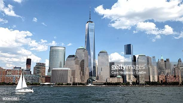 scenic view of sea and cityscape against sky - one world trade center stock pictures, royalty-free photos & images