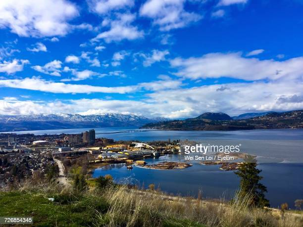 scenic view of sea and cityscape against sky - kelowna stock pictures, royalty-free photos & images
