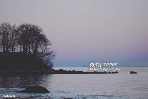 scenic view of sea and clear sky - michael blodgett stock pictures, royalty-free photos & images