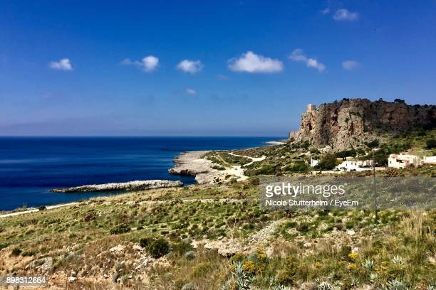 scenic view of sea and cliff against blue sky - stutterheim stock photos and pictures