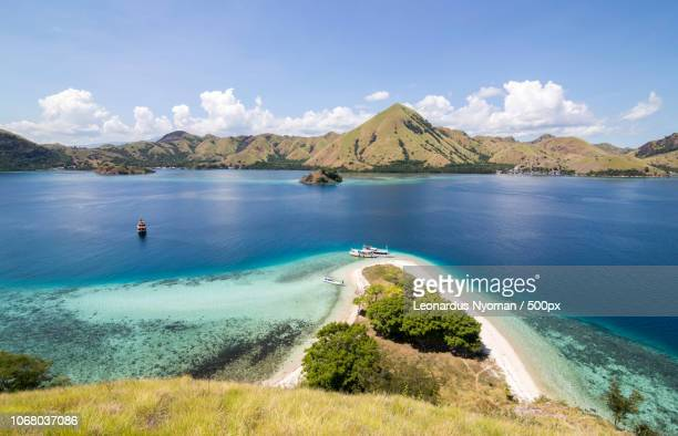 scenic view of sea and coastline, komodo national park, indonesia - east nusa tenggara stock pictures, royalty-free photos & images