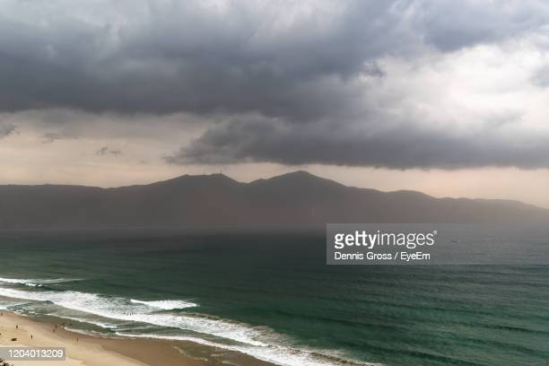 scenic view of sea and dinh ban co mountain during stormy weather - storm dennis stock pictures, royalty-free photos & images