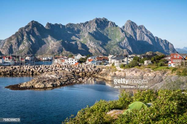 Scenic View Of Sea And Houses Against Clear Blue Sky