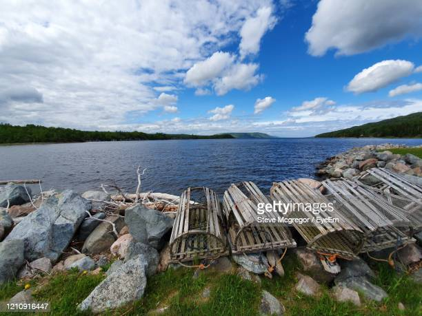scenic view of sea and lobster pots against sky - mcgregor stock pictures, royalty-free photos & images