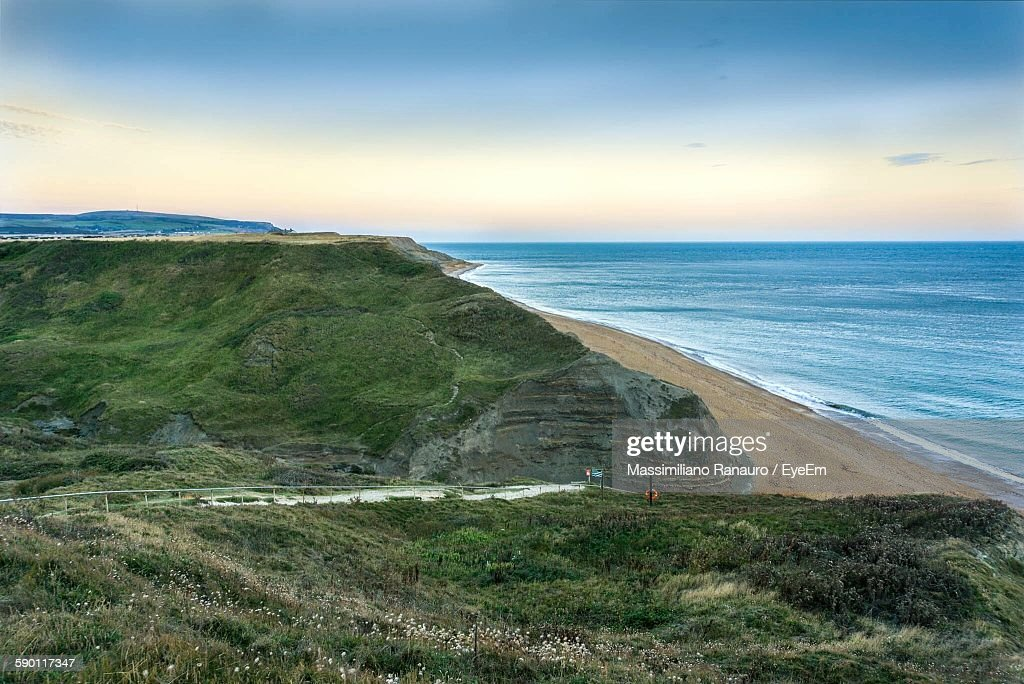 Scenic View Of Sea And Mountain Against Sky : Stock Photo