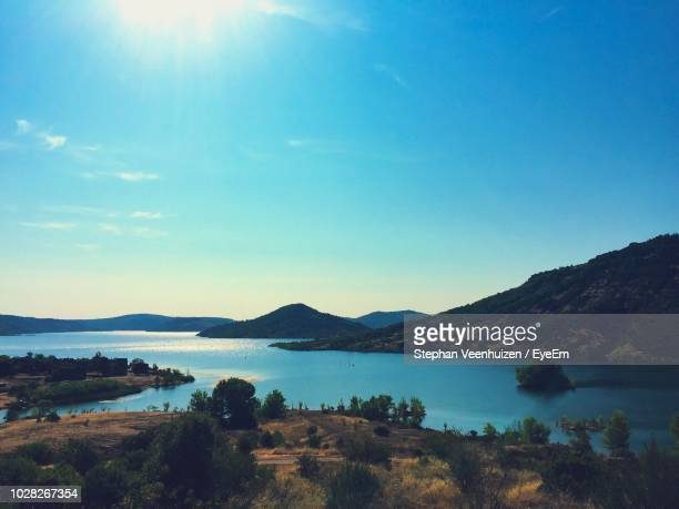 scenic view of sea and mountains against blue sky - herault stock pictures, royalty-free photos & images