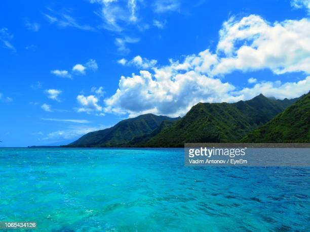 scenic view of sea and mountains against blue sky - antonov stock pictures, royalty-free photos & images