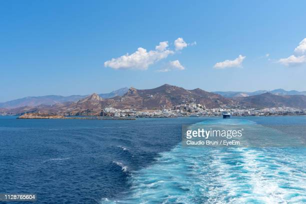 scenic view of sea and mountains against blue sky - naxos stockfoto's en -beelden