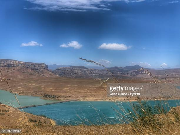 scenic view of sea and mountains against blue sky - durban stock pictures, royalty-free photos & images