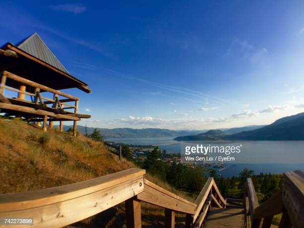 scenic view of sea and mountains against blue sky - kelowna stock pictures, royalty-free photos & images