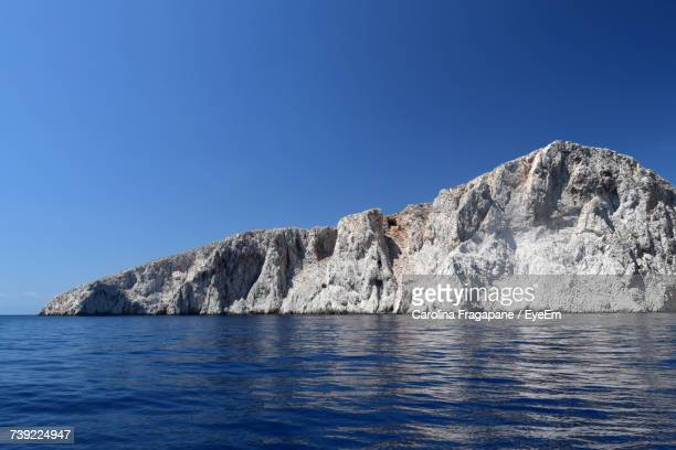 scenic view of sea and mountains against clear blue sky - carolina fragapane stock pictures, royalty-free photos & images