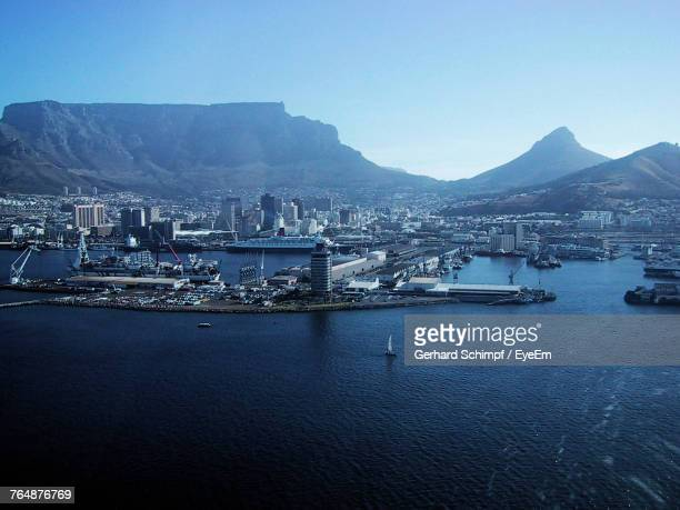 scenic view of sea and mountains against clear blue sky - gerhard schimpf stock pictures, royalty-free photos & images