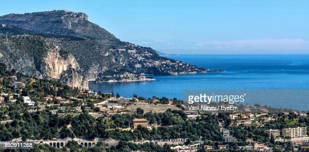 scenic view of sea and mountains against clear blue sky - alpes maritimes stock pictures, royalty-free photos & images