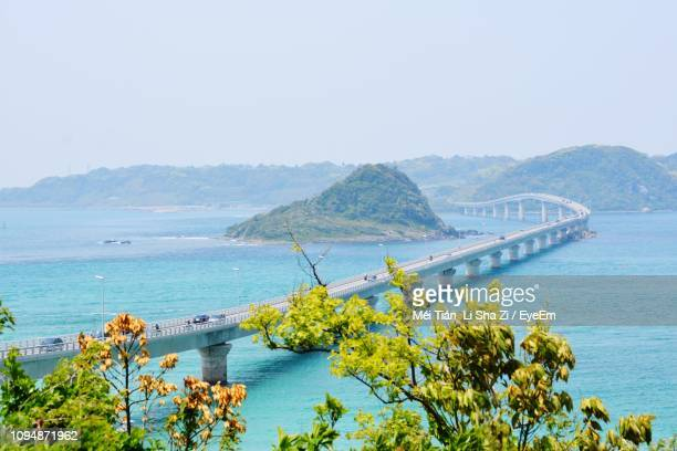 scenic view of sea and mountains against clear sky - 山口県 ストックフォトと画像