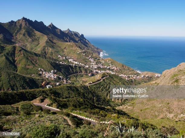 scenic view of sea and mountains against clear sky - marek stefunko stock photos and pictures