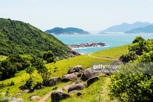 scenic view of sea and mountains against clear sky - fran�a imagens e fotografias de stock
