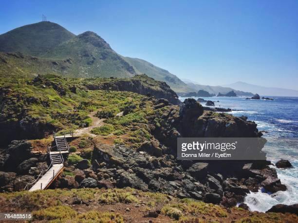 scenic view of sea and mountains against clear sky - baja california peninsula stock pictures, royalty-free photos & images