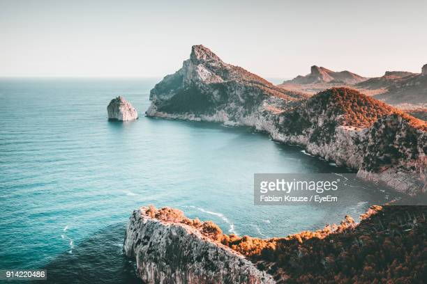 scenic view of sea and mountains against clear sky - majorca stock pictures, royalty-free photos & images