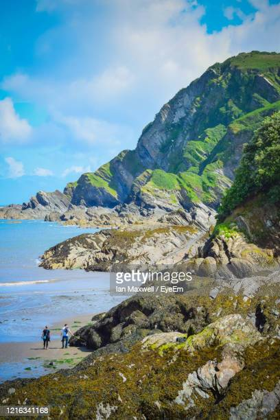 scenic view of sea and mountains against sky and large depth of field in ilfracombe, devon - ilfracombe stock pictures, royalty-free photos & images