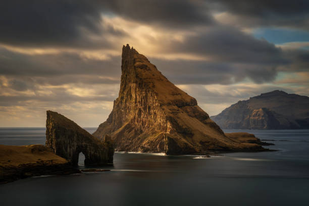 Scenic view of sea and mountains against sky during sunset,Faeroe Islands,Denmark
